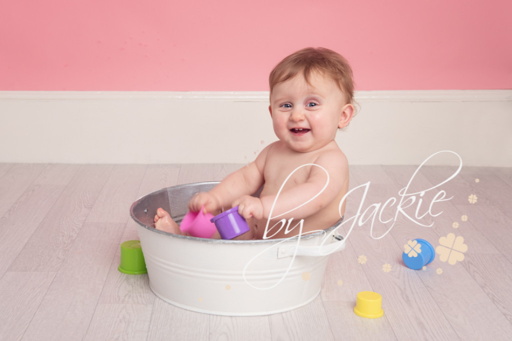 12 months old, baby's first year, first birthday smash and splash photo in tin bath by Babies By Jackie photography near York, Pocklington, Malton, Beverley and Hull, Yorkshire UK