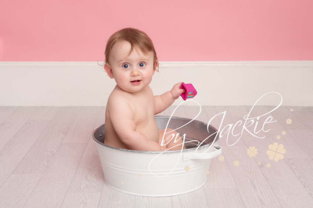 twins cake smash and splash milestone photo session with Babies By Jackie in Market Weighton, near York, Pocklington, Asselby, Hessle, Hull and Beverley in Yorkshire UK