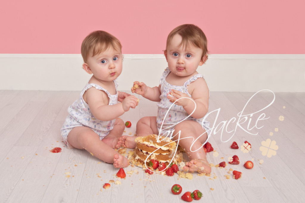 Twin girls first birthday cake smash photograph by Babies By Jackie near Beverley, Pocklington and York