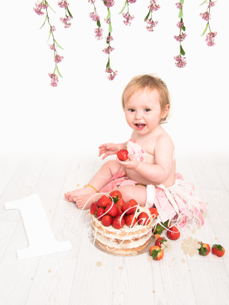 one year old baby girl cake smash and splash photo session with Babies By Jackie Photography in Market Weighton, Yorkshire, near Pocklington, York, Malton, Driffield, Hessle and Hull, East Ridings, UK
